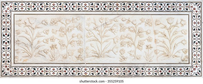AGRA - INDIA. SEPTEMBER 07, 2014. Mughal stone art on the facade of the Taj Mahal