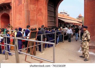 AGRA, INDIA-JANUARY 29: Unidentified people stand in line to get inside Taj Mahal complex on January 29,2011 in Agra, India. Agra is one of the most populous cities in Uttar Pradesh
