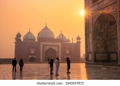 AGRA, INDIA-JANUARY 31: Unidentified people visit Taj Mahal at sunrise on January 31,2011 in Agra, India. Taj Mahal was designated as a UNESCO World Heritage Site in 1983.