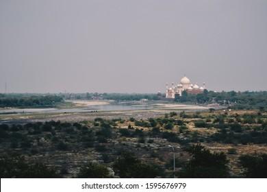 Agra, Uttar Pradesh / India - 06 19 2013: Distant view of the Taj Mahal