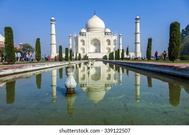 Agra, Uttar Pradesh, India - NOV 16, 2011: Visitors at the Taj Mahal complex in Agra, Uttar Pradesh, India. The Taj is still the only existing wonder of the world.