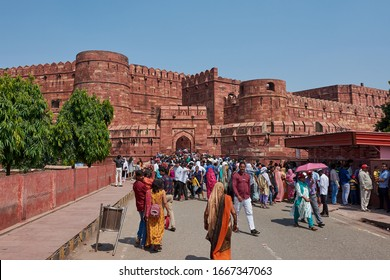 Agra, Uttar Pradesh / India - October 6, 2019: Tourists visiting the Agra Fort of the Mughal dynasty emperors, a UNESCO World Heritage site in Agra, Uttar Pradesh, India