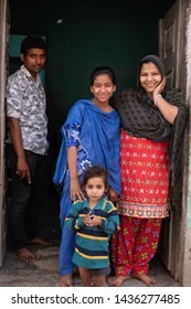 Agra, Uttar Pradesh/India - April, 2019: A family poses for a photo in a neighborhood not far from the Taj Mahal in Agra, India.