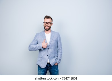 Agree good gesture symbol. Close up portrait of young successful brunet stock market broker guy on the pure light blue background, he is smiling, wearing smart casual