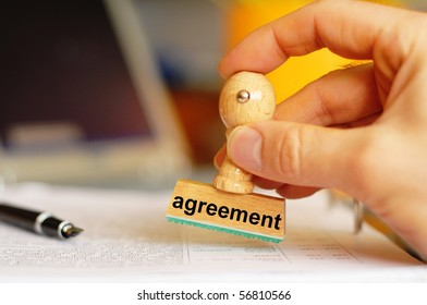 agreement or business deal concept with stamp in office