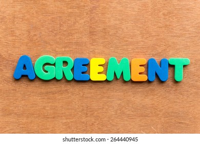 agreement colorful word on the wooden background
