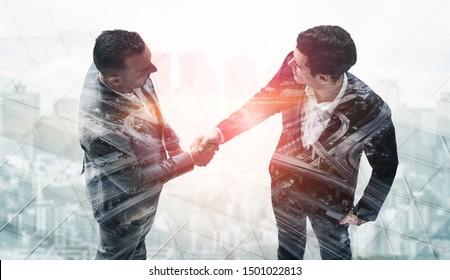 Agreement of Partnership Concept - Double exposure image of businessmen handshake. Corporate teamwork, trust partner and work agreement.