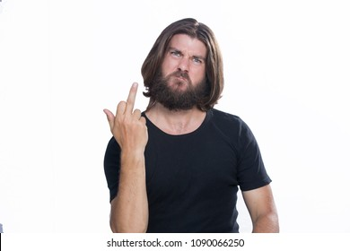 Agressive angry young man doing Screw You fuck sign with middle finger isolated on white background