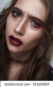 Agressive biker Girl with blue Eyes, wine Lips