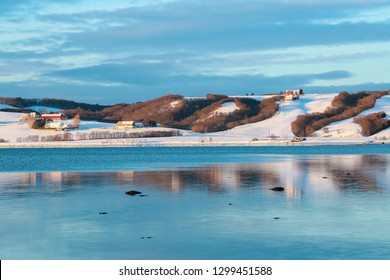 Agricultural area Byneset , located near the Norwegian city Trondheim, and Trondheim fjord during low tide in the winter