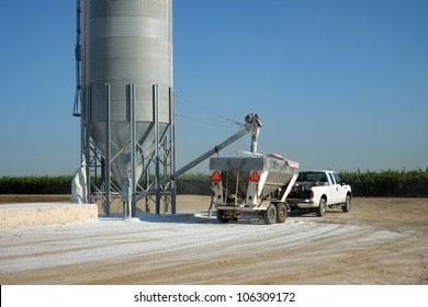 Agricultural chemicals are loaded from a storage tank into a trailer-mounted hopper on a Central California farm