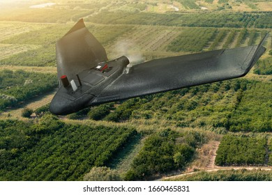 Agricultural drone flies over the field. Smart farming and digital transformation in agriculture.