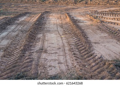 Agricultural field on which drove heavy vehicles. Ruts from the wheels in the mud, formed after the rain
