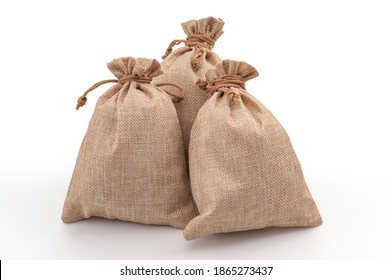Agricultural hessian cloth sacks, rough sack material and linen fabric textile concept with pile of three brown burlap or sackcloth bags isolated on white background with clipping path cutout