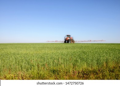 Agricultural machinery. Self-propelled sprayer works on a field under a blue sky. Russia. Tatarstan. 3 July 2019.