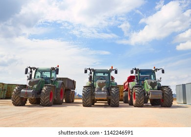 Agricultural machinery. Three heavy industrial tractors view