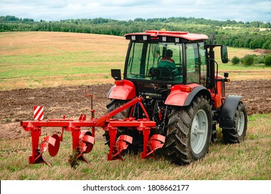 Agricultural plow for deep plowing, Plowing the field. Large plow on a tractor. Tractor with agricultural attachment. Subsoiler or flat lifter.
