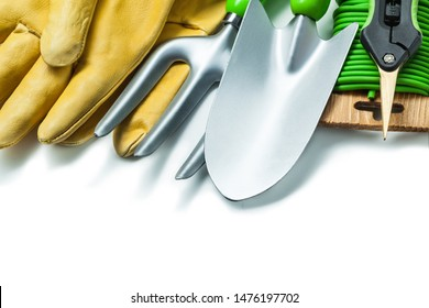 agricultural set tools hand spade fork gloves garden secateurs and rope isolated on white