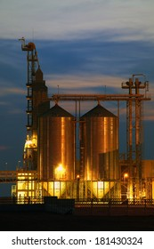 Agricultural Silo - Building Exterior, Storage and drying of grains, wheat, corn, soy, sunflower .Night photo.