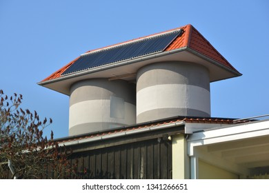 Agricultural Silo with Solar Panel on a small tiled Roof