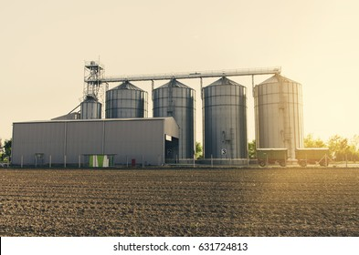 Agricultural silos on sunset