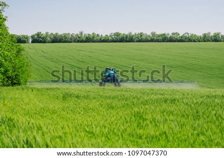 Agricultural Sprayers Spray Chemicals On Young Stock Photo