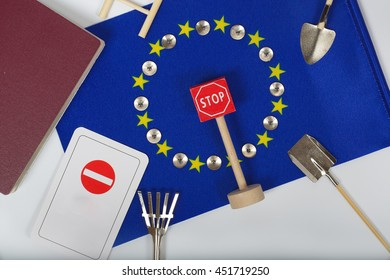 Agricultural tools,a card with access forbidden,pins,and a passport on an European flag. Free space for a text