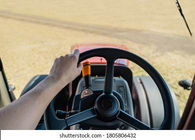 Agricultural tractor on the field. Driver's point of view