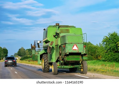 Agricultural tractor in the road in Poland.