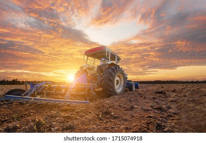 Agricultural tractors working cultivating preparing planting area, machinery, buoys, saving labor costs in the agricultural industry, agricultural tools, modern farming, smart farms, logistics technol