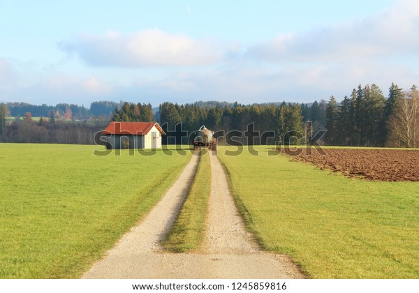 Agricultural vehikel on a rural road, Bavaria, Germany