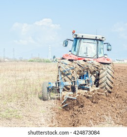 Agricultural work.  Tractor plowing the stubble field
