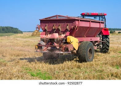 Agricultural works. Spreading fertilizer before plowing the stubble