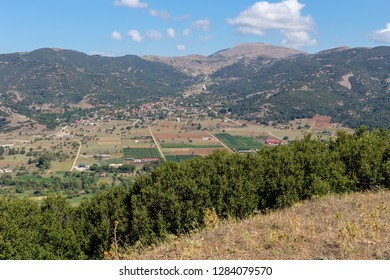 Agriculture. Agricultural land and the city of Kalavryta from a height in the valley near the mountains on a sunny summer day(Achaea, Greece, Peloponnese)