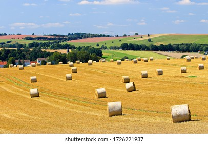Agriculture farm field haystacks landscape. Haystack rolls on agriculture field