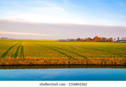 Agriculture farm field river landscape. Agriculture farmland scene. Agriculture farm field river stream canal panorama