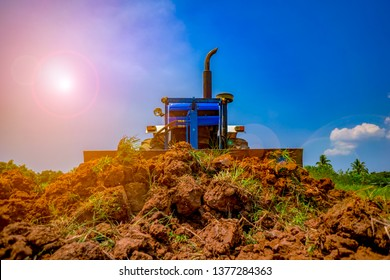 Agriculture farming concept, soil pile from tractor working on farm agriculture in countryside on summer