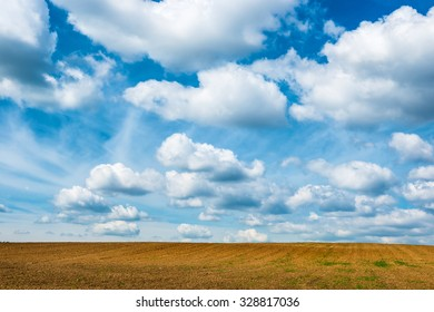 Agriculture field and blue sky with clouds.