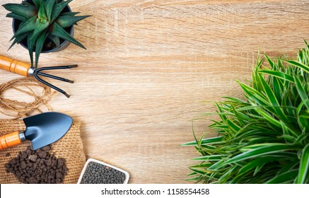 Agriculture and gardening equipment on wood table background for template and slide presentation design