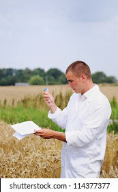 Agriculture scientist or student in the field verifying results of experiment