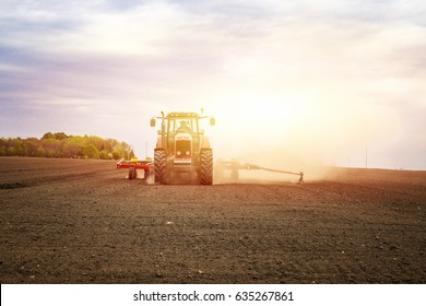 Agriculture. Tractor working on the field. Outdoor activities.
