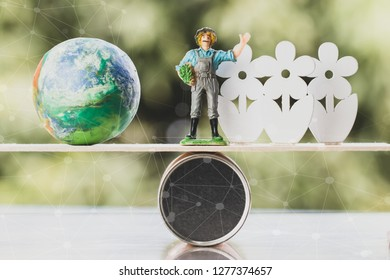 Agriculture World environment concept: Miniature smart farmer with Global model with wood white flower on wood round box balance, network line background. Environmental conservation for life in future