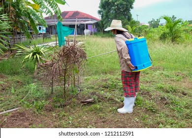 agriculturist spraying pesticides fertilizers, agriculturist uses chemicals on the farm, Farmers use herbicides.