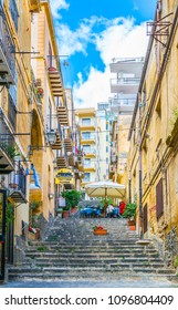 AGRIGENTO, ITALY, APRIL 22, 2017: View of a narrow street in the historical city of Agrigento in Sicily, Italy