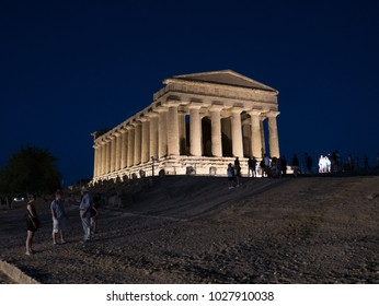 AGRIGENTO, Sicily. August 2017: the Valley of the Temples of Agrigento, an ancient greek temple, perfectly preserved and part of the Unesco World Heritage sites, enlightened at night on the top hill.