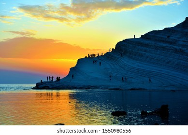 AGRIGENTO SICILY ITALY SEPTEMBER 18 Tourists watching the sunset and enjoying the sea at the Scala dei Turchi (Stair of the Turks) September 18 2019 Agrigento Sicily