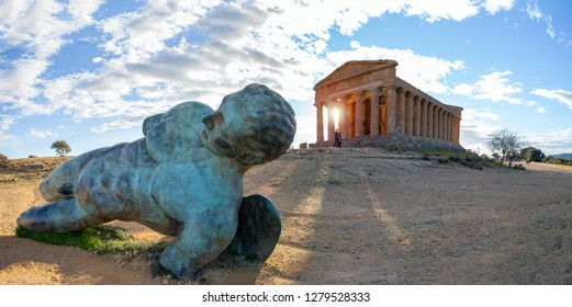 Agrigento, Sicily/Italy. January 05, 2019:  A massive sculpture of Icarus lies in front of the Concordia Temple in the Valley of Temples in Agrigento, Sicily.