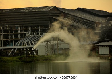 agroindustry factory during sunrise, beauty in nature factory with smog on orange sky background