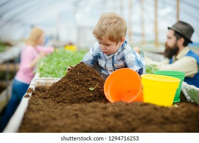 agronomist. little agronomist in greenhouse. agronomist working in farm. small agronomist concept