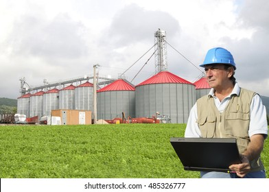 Agronomist working in silos